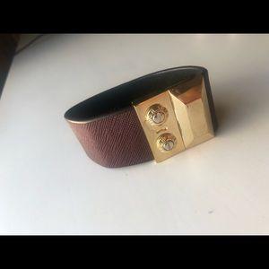 Henri Bendel gold and purple cuff link bracelet